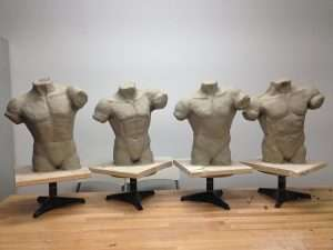 figurative sculpture of male bust in process